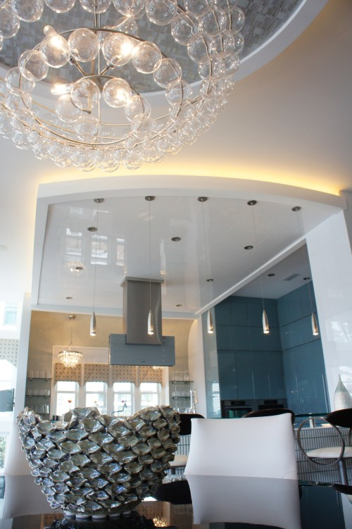 I love this dining chandelier, with its swirling rows of glass balls.  Here you can also see the ceiling treatment we used in the Kitchen.  It is a product called White Ice, which is a man-made version of white thassos granite.  We loved the reflective quality it has, and the way it mirrors the lights from the kitchen windows.
