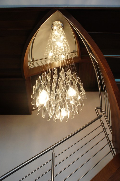I designed this custom stairwell light to suspend through three stories!
