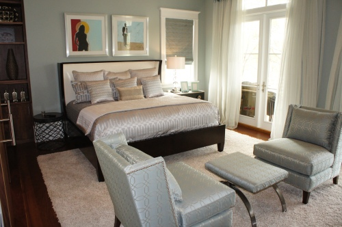 This Guest Bedroom is furnished with a modern King wing bed by Hickory White, a coordinating nightstand, and small round table.  The plush shag area rug anchors the room and provides a soft cushion for the toes!