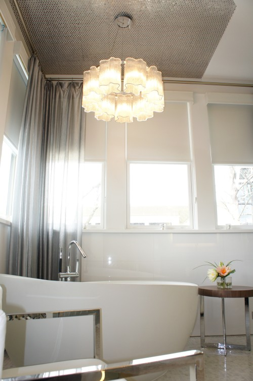 Here you can see a glimpse of the stainless penny round tile we placed on the ceiling above the tub.  They twinkle against the chandelier, and help define the space, making it more intimate.  The silver-thread sheers do this, as well, while adding an ethereal quality.