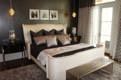 The ostrich leather king bed contrasts nicely with the smoldering charcoal gray wall finish.