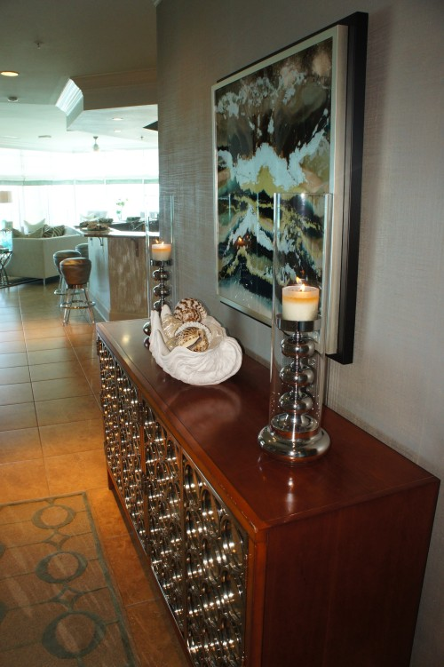 This entry console was the only original piece of furniture we kept by the end of the remodel.  We think we breathed in it some new life here!