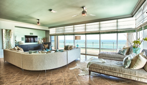 We anchored the lounge area with a large cow hide.  In the media niche, we built a floating modern console on a backdrop of a green painted accent wall.