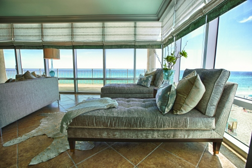 "Two Century chaise lounges add some ""swag"" to this sitting area.  Plush gray croc chenille fabric adds some richness against the blue and white backdrop of the ocean!"