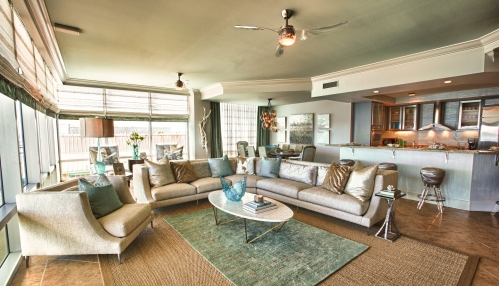 This large sectional provided some sophisticated and inviting seating to this large living area.  We layered a plush blue wool area rug on top of a large woven jute.  The oval white-shell top cocktail table by Oly was the perfect size and shape for the arrangement.