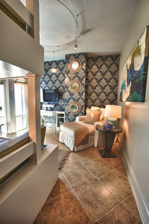 This blue printed wallcovering brought weight and emphasis to the other side of the room.  It was the perfect backdrop for the chaise lounge and white built-in desk.