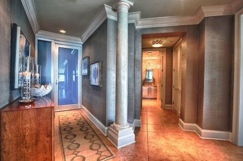 This shot allows you to see the Entry and Powder Bath entrance.  The walls here are a silver linen textured faux finish, and the columns were given a pearlescent finish.