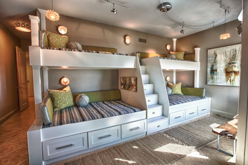 Custom built-in bunk beds: We utilized the length and unique shape of the room by building a double twin-over-full bunk wall.