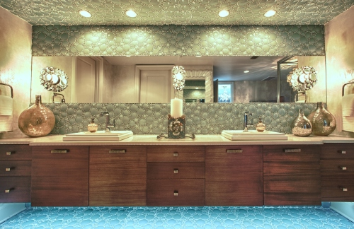 The old cabinetry was removed and replaced with this floating double vanity.  The green glass bubble tiles on the backsplash are divided by one long horizon mirror at eye level.