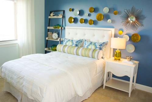 "I painted these walls a pale aqua color, then gave the bed wall a dramatic ""punch"" of blue that contrasts well with the bed and wall décor."