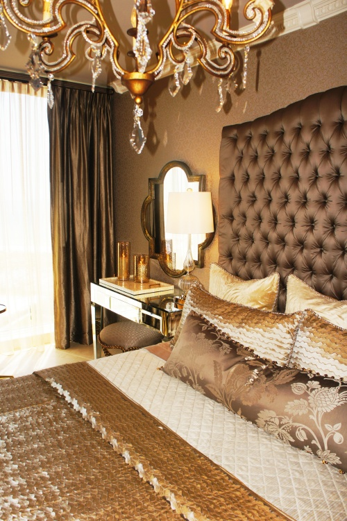 Here you can see how I mixed textures and finishes for an opulent, inviting feel.  Cut velvets and dark taupes counterbalance shimmering silks and taffetas, glittering crystal and reflective mirrored vanity.  The foot blanket shines and reflects light, almost like water!