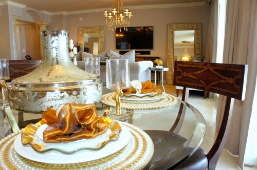 "This table top is all set up for elegant entertaining, with its gold and white ""bling.""  The pearl and stud chargers anchor the white Waterford dinner plates and gold-rimmed ruffle Annie Glass dessert plates.  In the center, the mercury glass Moroccan vase is just waiting for some fresh flowers!"