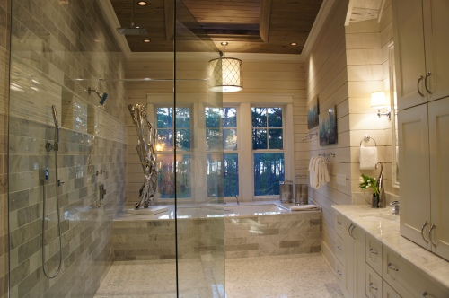 This is a stunning bathroom, with its marble floors and walls, the large open windows and recessed ceiling detail.