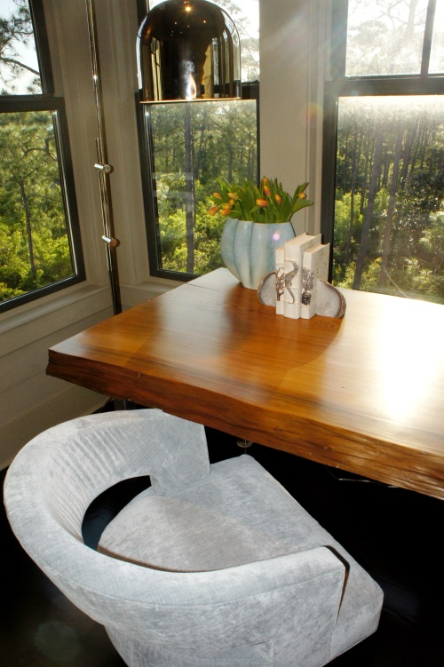 This desk used to be a counter-height dining table on the second floor.  I had the legs shortened to desk height, and then silver leafed and sealed to protect against rusting.    Placed against these windows, this desk provided an ideal area to work!