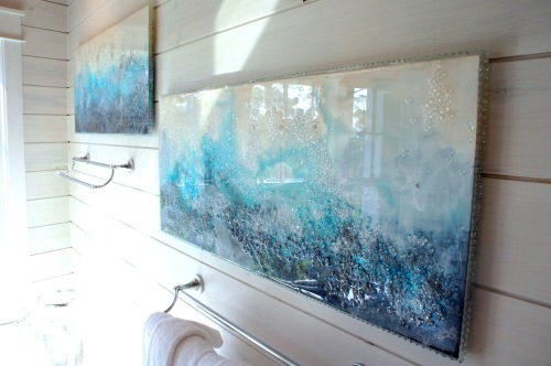 I commissioned local artist, Mary Hong, to design us some beautiful eye-popping artwork in this room.  These are acrylic panels, to which she added glass and dye, then a finishing resin.