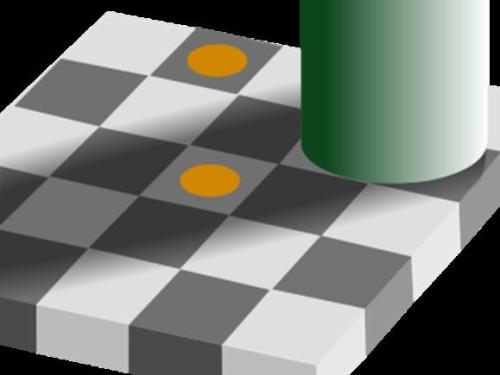 In this diagram created by Edward H. Adelson, the two yellow dots are actually the same color.  The gray squares they are centered in are also the same value! Because the surroundings are different, they are perceived differently.