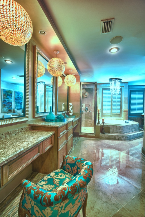 The Master Bathroom was given a makeover, with new cabinets and countertops, a faux finish wide stripe gracsscloth texture on the walls, and some eye-catching new lighting.
