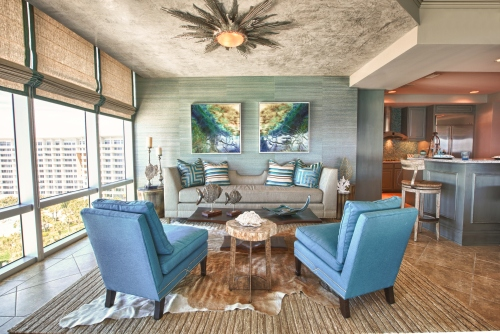 "Inviting layers of texture help to define this space as the ""Lounge"".  Grasscloth and linen bring a natural element, while a plush area rug, layered with a cowhide add softness.  The dropped ceiling was texturized with a venetian plaster, which resembled shiny concrete."