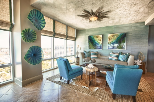 It is just as important to think about your ceiling in a design, as it is to dress your walls and floors.  Instead of an expected flush mount light, try what I call a ceiling-crawler, like this fabulous star fixture by Global Views!