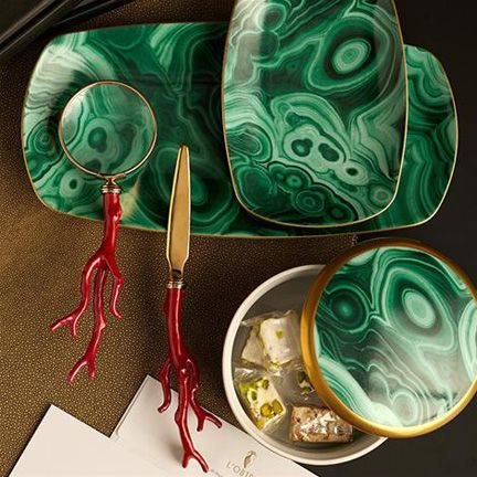 Some malachite dinnerware by L'Objet