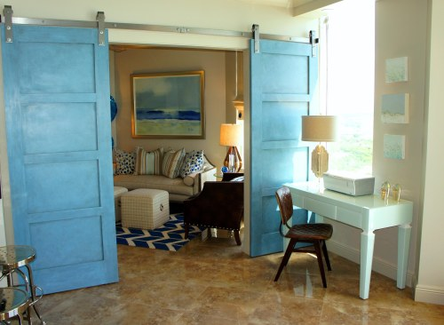 These custom barn doors, leading to the Den, add a touch of modern, and a touch of coastal charm! I  had them finished in the same powder blue as the entertainment console in the Living Room.