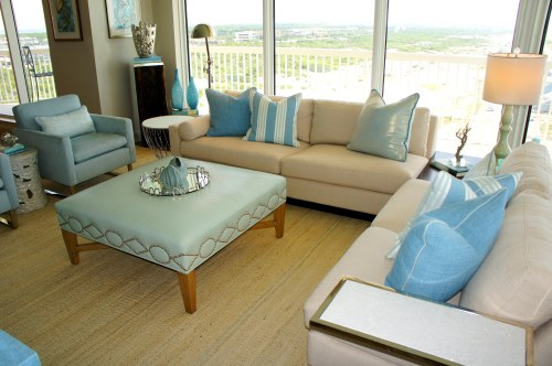 Having a sectional, with a low back and open corner allows the coastal seascape backdrop to shine!