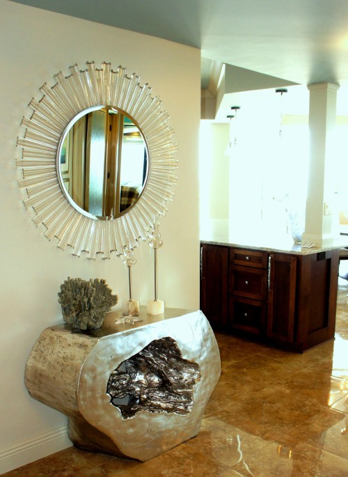 When you enter from the private elevator, this modern acrylic mirror and resin-cast silver leaf console table is what greets you!  I watned to make a statement in this small space!
