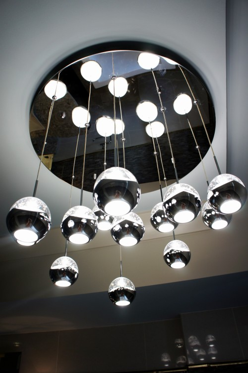 "Here is the chandelier I used, which is the ""Ice"" 13-light pendant manufactured by Eurofase."