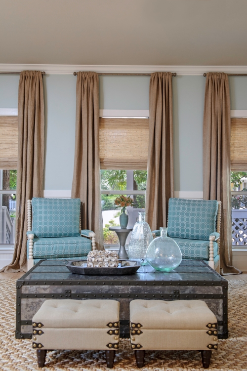 "I gave the walls some ""love"" and attention, by applying beadboard up to 42"".  Grassweave Roman shades in the windows added texture, and the long burlap drape panels created some much-needed height and drama!"