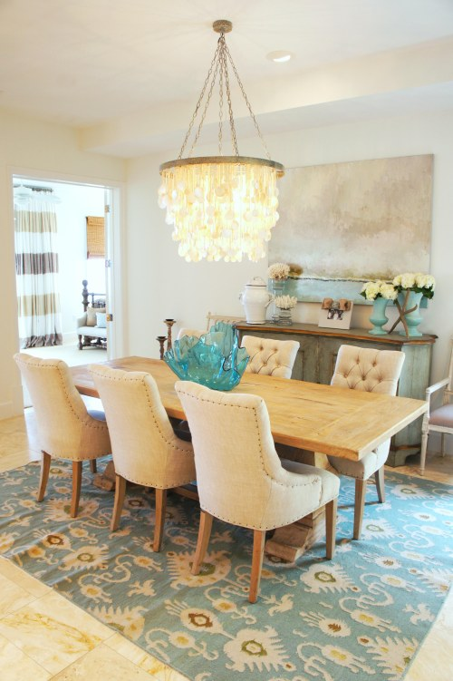 I found these upholstered dining chairs at Duh in Pensacola, and the ikat flat weave wool area rug from Nest Interiors in Panama City Beach!  (I told you I shopped everywhere!)