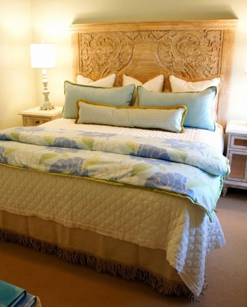 In this room, I used this fabulous carved wood headboard that I found at Nest Interiors, and paired it with some jute fringe euros, and some custom pillows.  I absolutely love the aqua, green and periwinkle color combination in this foot blanket!