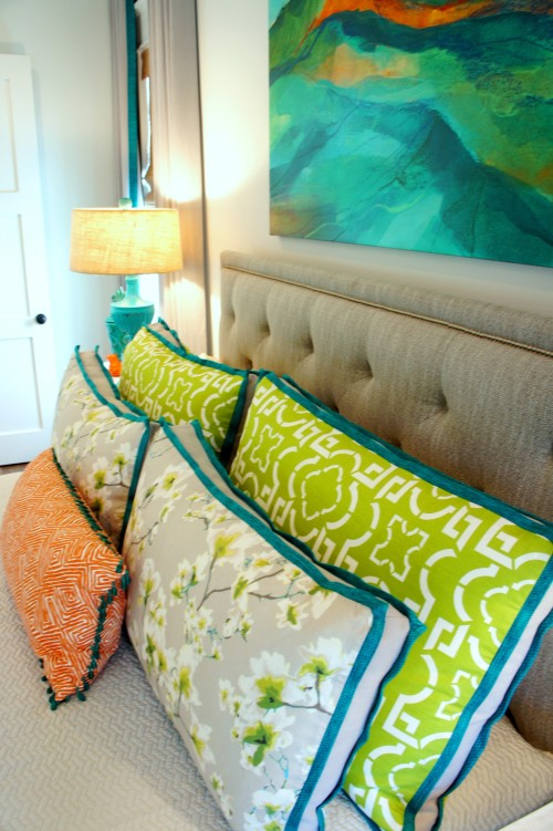 I love to mix florals with geometrics when choosing fabrics.  It's always fun to throw in one unexpected color (in this case, orange), to liven things up!