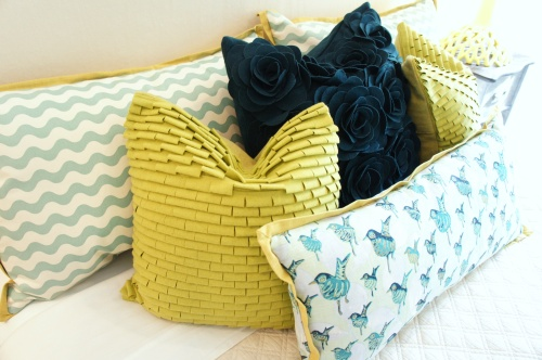 The bird print and the waves fabrics are by Lulu DK; the felt applique pillows are by Surya. Cute eclectic mix of colors, textures and pattern!