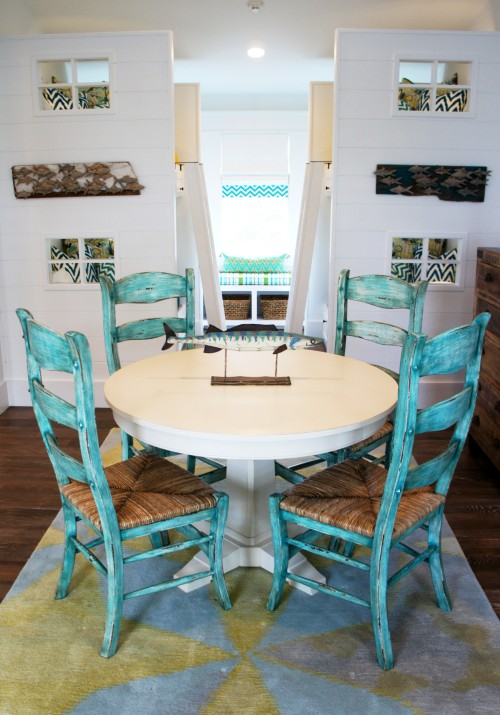 This game table and chairs is a nice place to have a snack, make art, or play games!