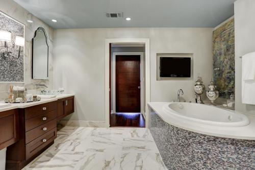 Master Bath After: We created a beautiful, open and functional double vanity, with ample lighting.  We also added a brand new oval tub, with curved tub deck.