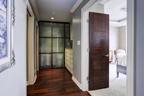 HIS closet AFTER:  Look at these gorgeous frosted glass sliding doors!  They dress the closet up, keep the room feeling open, and look totally handsome and rich!